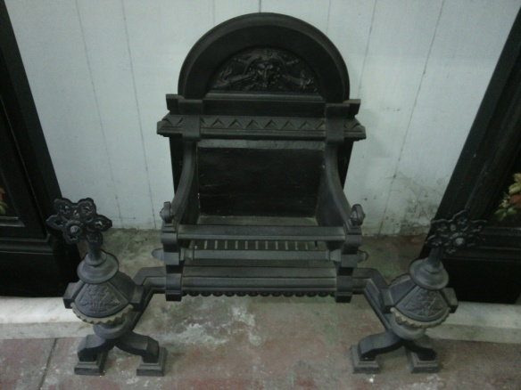 Grand Victorian cast iron freestanding fire basket with dogs. (detail) with face, flaming torches and snakes! w 900 x h 700 x d 450mm $745 salvage recycled demolition, secondhand, used, original, old, heritage, antique