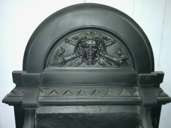 Grand Victorian cast iron freestanding fire basket with dogs. (detail) with face, flaming torches and snakes! w 900 x h 700 x d 450mm $745 Grand Victorian cast iron fireplace original (detail) with face, flaming torches and snakes! grand Victorian cast iron fireplace original (detail) salvage recycled demolition, secondhand, used, original, old, heritage, antique salvaged, recycled, demolition, reproduction, restoration, renovation,collectable, secondhand, used , original, old, reclaimed, heritage, antique, victorian, edwardian wood burner, open fire