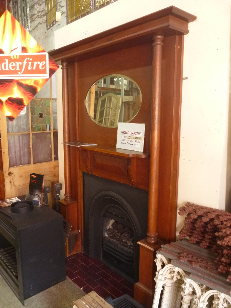 Original cast iron fireplace insert retrofitted with Wonderfire gas burner