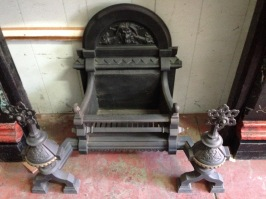 Ornate fire basket, cast iron with face, snakes and flaming torches