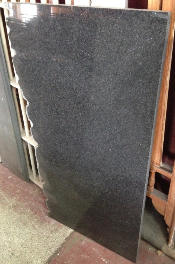 Polished granite slab / hearth, grey black, 1300 x 560 x 30mm, $150