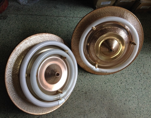Art deco 'flying saucer' ceiling lights with double circular fluoro lights. Copper/brass finish, two available (one has small fluoro missing)