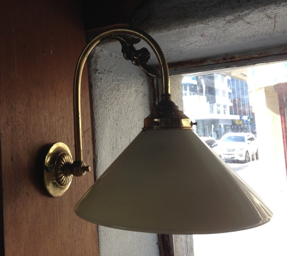Brass gooseneck wall light, pale yellow glass shade $10