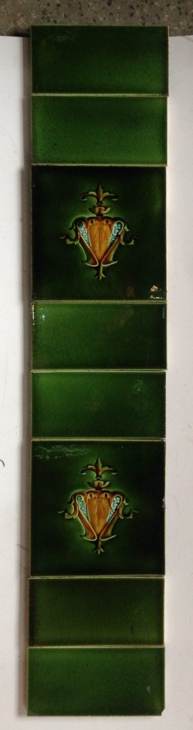 Original fireplace tile set, two picture tiles each side, green with blue and yellow/brown stylised flower motif, $135 for the full set of both panels