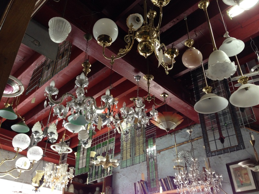 Decades of lighting; chandeliers, Art Deco, milk shades, fluoro...