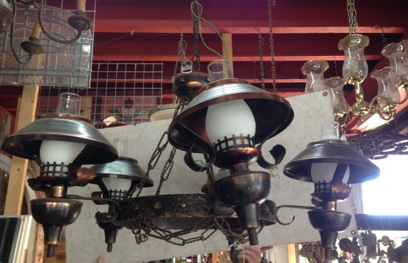 Interesting copper/bronze finish ceiling light, five arm with chains approx. 950mm diameter, 2 available $440 each