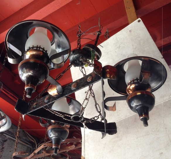 Interesting copper/bronze finish ceiling light, three arm with chains approx. 650mm diameter, $330