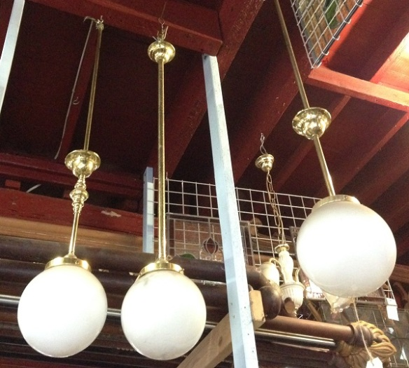 Ceiling lights with ball shades, white 18-20cm diam. Brass pole (two matching, one similar) $60 each