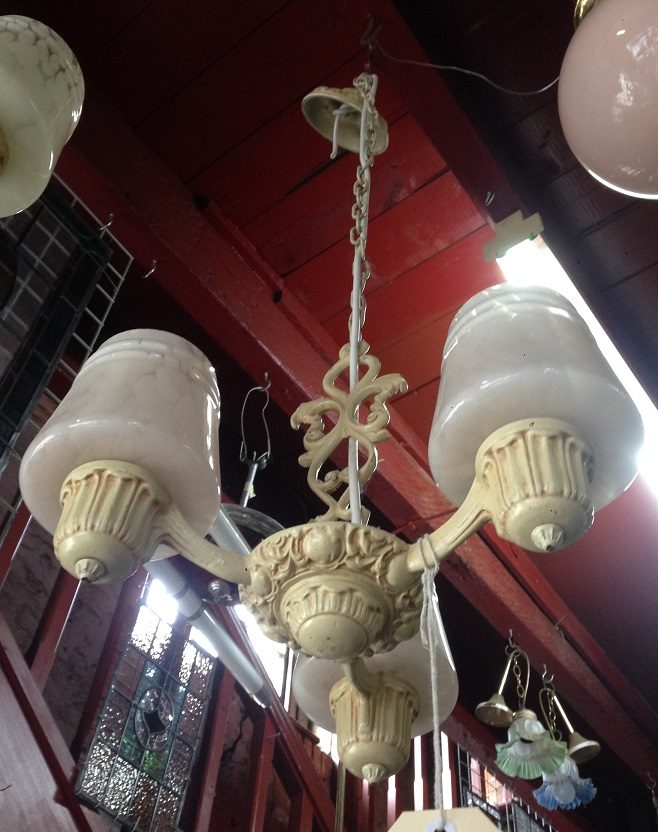 Vintage three arm pendant light circa late 1940s early 50s, diecast with glass shades, approx diameter 370cm, pale yellow shades, $175