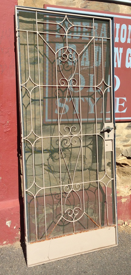 Steel security screen door in frame, wrought iron, w890 x h2090mm $300