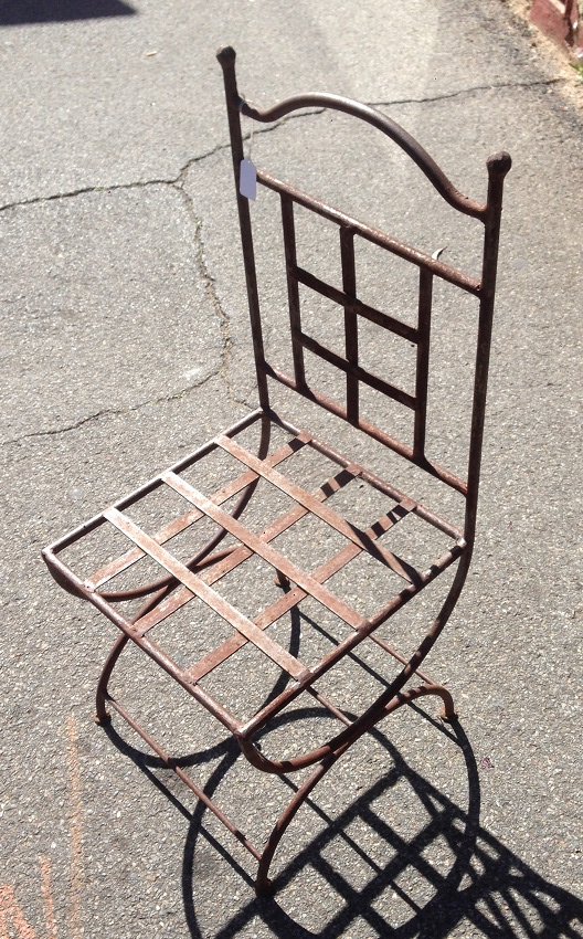 Wrought iron and strap iron chair $75