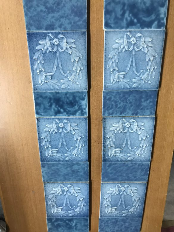salvaged, recycled, demolition, reproduction, restoration, renovation, collectable, second hand, used, original, old, reclaimed, heritage, Victorian, Edwardian, Art Deco, Georgian lovely original tile set with wreaths and mottled blue half tiles $ 200 the set OTB