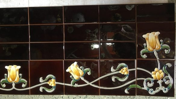 Reproduction tile hearth set (detail), deep brown with yellow tulip border pattern w1370 x d456mm $480 salvaged recycled demolition, reproduction, restoration, renovation,collectable, secondhand, used , original, old, reclaimed, heritage, antique, victorian, edwardian, georgian art nouveau ceramic arts and crafts decorative aesthetic v