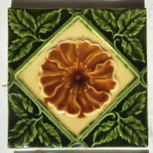 Corn Bros England, original fireplace tile set, Aesthetic Floral Majolica c1900-1910, 3 available $35 each - scuffs on some high points not shown in this image WS Corn Bros England, original fireplace tile set, Aesthetic Floral Majolica c1900-1910, 8 available WS salvaged, vintage recycled, demolition, reproduction, restoration, home renovation secondhand, used , original, old, reclaimed, heritage, antique, victorian, art nouveau edwardian, georgian, art decoDetail of Deco style lettering to pub door