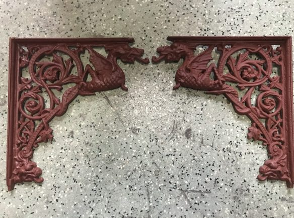 salvaged, recycled, demolition, reproduction, restoration, renovation,collectable, secondhand, used , original, old, reclaimed, heritage, antique, victorian, edwardian, georgian, deco cool cast iron corner brackets, with dragon motif, 4 left hand and 4 right hand available, $ 95 each