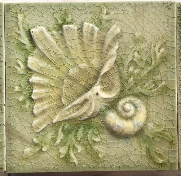 salvaged, recycled, demolition, reproduction, restoration, renovation,collectable, secondhand, used , original, old, reclaimed, heritage, antique, victorian, edwardian, georgian, deco AET Co/ American Encaustic Tile Co. Victorian era fireplace tile set of 10 tiles. Seashell design, soft green with some pale yellow and pink highlights. $330 for the set