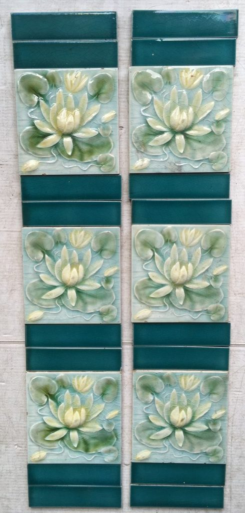 AET Co/ American Encaustic Tile Co. Victorian era fireplace tile set of 10 tiles. Water lily design in relief, pale blue, green and yellow. $300 for the setsalvaged, recycled, demolition, reproduction, restoration, renovation,collectable, secondhand, used , original, old, reclaimed, heritage, antique, victorian, edwardian, georgian, deco fireplace tile
