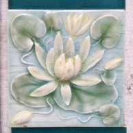 detail of AET Co/ American Encaustic Tile Co. Victorian era fireplace tile set of 10 tiles. Water lily design in relief, pale blue, green and yellow. $320 for the set OTB salvaged, recycled, demolition, reproduction, restoration, renovation,collectable, secondhand, used , original, old, reclaimed, heritage, antique, victorian, edwardian, georgian, deco fireplace tile