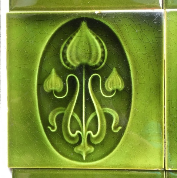 Early 1900s fireplace tile set of two panels. embossed with green glaze $180 for the two panel set SET101 salvaged recycled demolition, reproduction, restoration, renovation,collectable, secondhand, used , original, old, reclaimed, heritage, antique, victorian, edwardian, georgian art nouveau ceramic arts and crafts decorative aesthetic