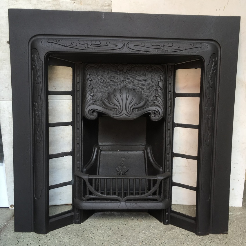 Restored original cast iron fireplace insert, $550