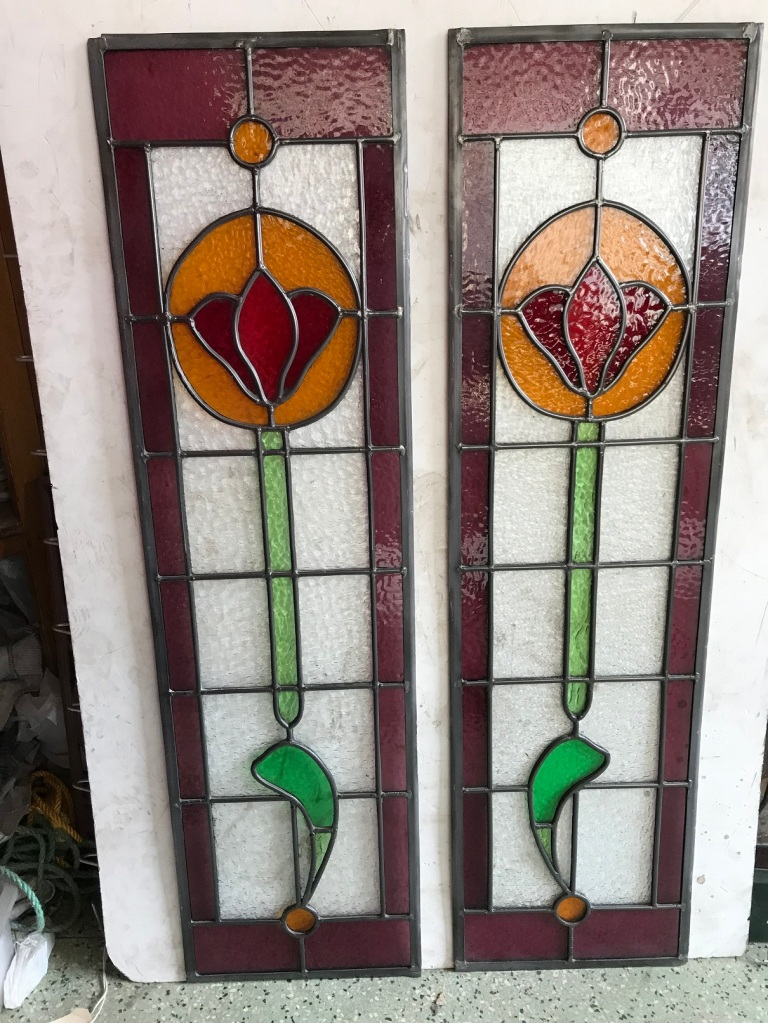 Leadlight panels with pink , green , red and yellow/orange glass, 2 available , 995 mm x 275 mm, $ 275 each salvage recycled demolition, reproduction restoration, renovation, collectable, secondhand, used, original, old, reclaimed heritage, antique restored stained glass