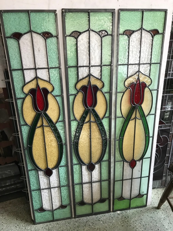 Leadlight panels, 3 available , with light and dark green , red and amber glass , 1125 mm x 225 mm , $ 245 each , salvage recycled demolition, reproduction restoration, renovation, collectable, secondhand, used, original, old, reclaimed heritage, antique restored stained glass