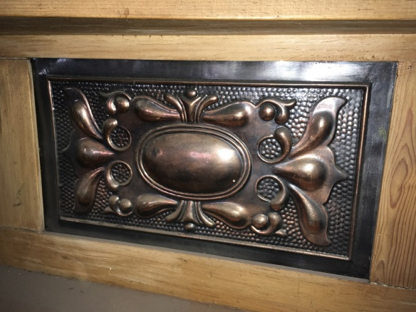 tall Kauri pine fireplace mantel, Florentine bronze pressed tin inserts, w 1300 x h 1950mm, $330