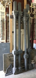 Set of four original cast iron verandah posts with heavy cast brackets