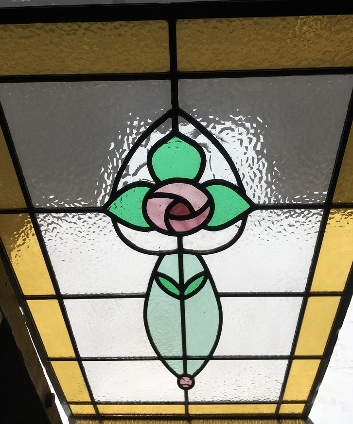 Detail of colourful leadlight window panel, stylised rose and leaves, pinks, greens and warm yellow border, 775 mm x 482 mm , $345 salvage recycled demolition, reproduction restoration, renovation, collectable, secondhand, used, original, old, reclaimed heritage, antique restored stained glass