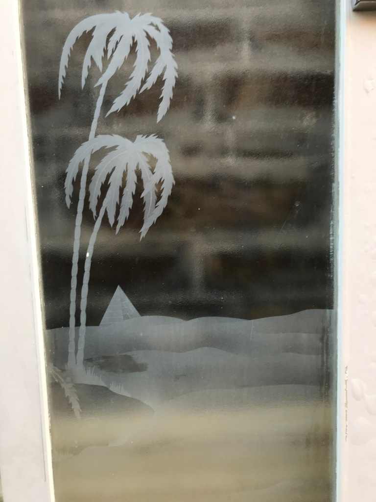 Detail on pair of external French doors with palm trees, camel and pyramid etching , 2025 mm tall x 1525 mm wide , $695