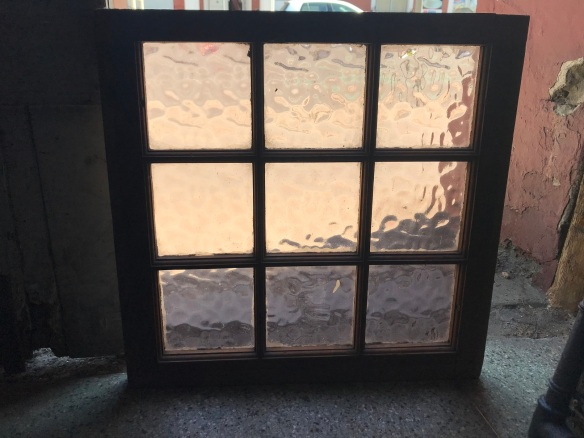 small red pine frame window with pale rose coloured glass , 9 panes 550 mm x 535 mm, $55 salvage recycled demolition, reproduction restoration, renovation, collectable, secondhand, used, original, old, reclaimed heritage, antique restored stained glass