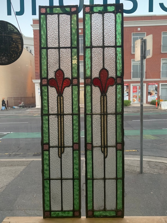 Original pair of lead light panels , 1115 mm long x 215 mm wide , with green , red, pink and clear glass, $ 265 each panel