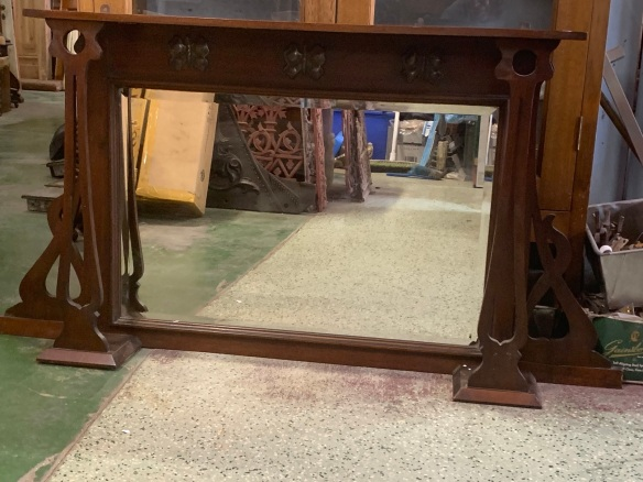 Small Arts and Crafts timber overmantle with pressed metal butterflies, 122 mm wide x 640mm tall, $275