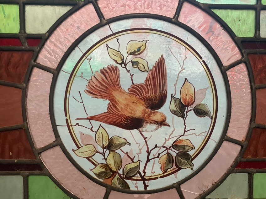 Detail of hand painted bird in lead light fanlight panel