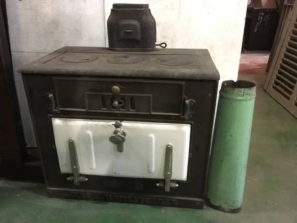 """salvaged, recycled, demolition, reproduction, restoration, renovation,collectable, secondhand, used , original, old, reclaimed, heritage, antique, victorian, art nouveau edwardian, georgian, art deco Wood stove """"MBP Homesteader"""", cast iron, width 765 x depth 500 x height (without flue) 660mm $440"""