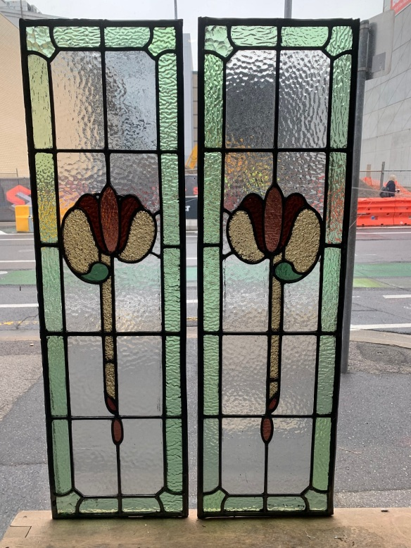 salvaged,Pair of Leadlight panels , with stylised floral emblem , green, pinks and yellow glass, 955 mm x 282 mm , $ 330 each , 2 available recycled, demolition, reproduction, restoration, renovation,collectable, secondhand, used , original, old, reclaimed, heritage, antique, victorian, art nouveau edwardian, georgian, art deco