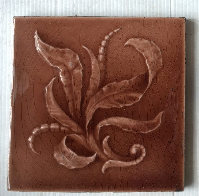Original Sherwin and Cotton fireplace tiles, c1890 - 1911 warm pink / brown glaze on moulded tile with foliage. $300 for the two panel set SET 142 salvaged, recycled, demolition, reproduction, restoration, renovation,collectable, secondhand, used , original, old, reclaimed, heritage, antique, victorian, art nouveau edwardian, georgian, art deco