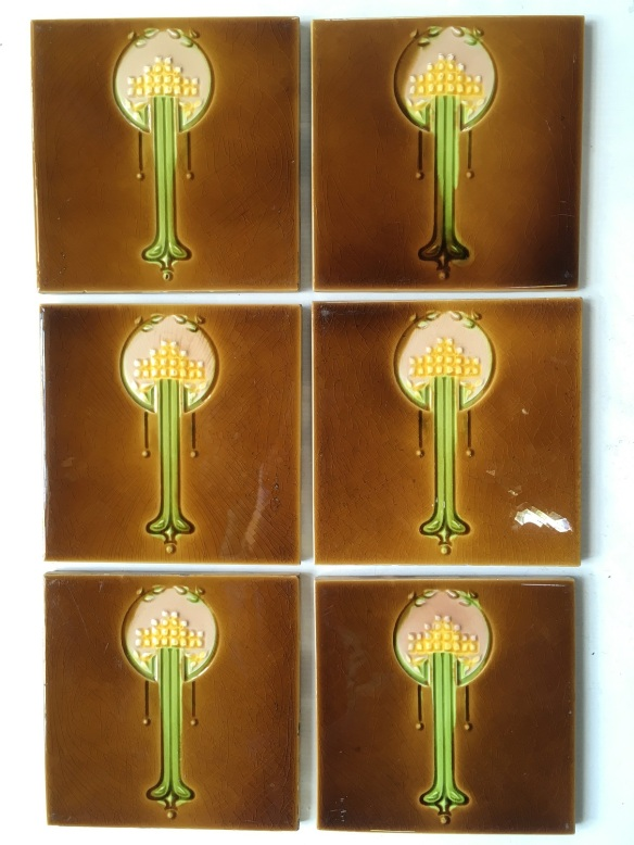 Original Johnson feature tiles, England c 1930, stylised flowers in yellow, amber brown glaze, 6 available $80 per pair SET 258salvaged, recycled, demolition, reproduction, restoration, renovation,collectable, secondhand, used , original, old, reclaimed, heritage, antique, victorian, art nouveau edwardian, georgian, art deco