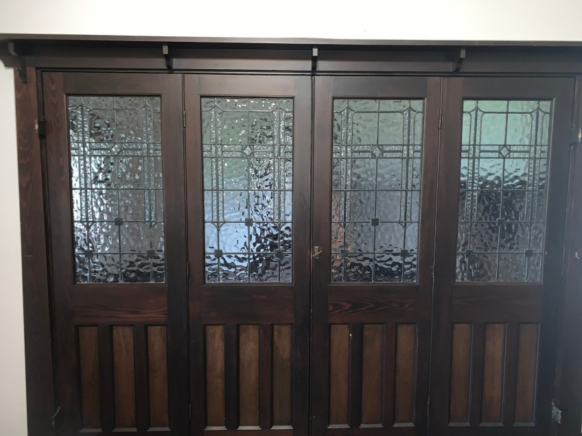 , with leadlight panels , original polished finish , parliament hinges , opening is 2560 mm wide x 1995 mm tall , $ 2150 BIFOLD SET, picture depicts the doors in situ before removal salvaged, recycled, demolition, reproduction, restoration, renovation,collectable, secondhand, used , original, old, reclaimed, heritage, antique, victorian, art nouveau edwardian, georgian, art deco