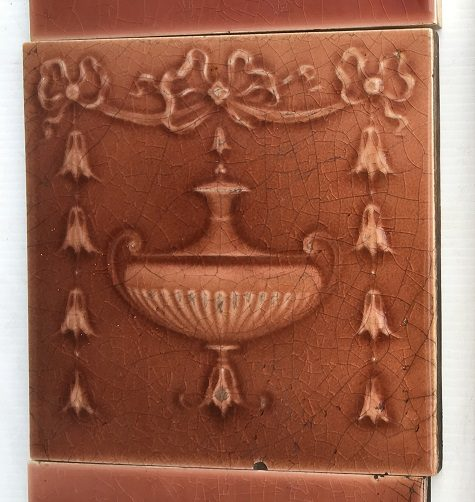 Detail of H. Richards Tile Co c1902-1909, 6 x 6 inch feature tiles, madder pink/brown glaze, moulded urn and garland design, $320 for the 2 panel fireplace set, OTB 6salvaged, recycled, demolition, reproduction, restoration, renovation,collectable, secondhand, used , original, old, reclaimed, heritage, antique, victorian, art nouveau edwardian, georgian, art deco