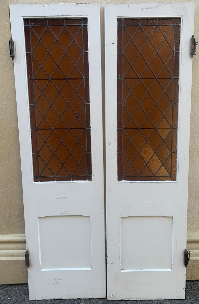 Pair of French doors with Harlequin / diamond pattern leadlight panels , 1130mm + , x 2120mm tall , $525 the pair salvaged, recycled, demolition, reproduction, restoration, renovation,collectable, secondhand, used , original, old, reclaimed, heritage, antique, victorian, art nouveau edwardian, georgian, art deco