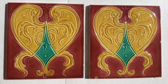 Original Lea and Boulton tiles c1900, light burgundy with warm yellow and emerald, One has chips to the edge $25, other is $35 WS salvaged, recycled, demolition, reproduction, restoration, renovation,collectable, secondhand, used , original, old, reclaimed, heritage, antique, victorian, art nouveau edwardian, georgian, art deco