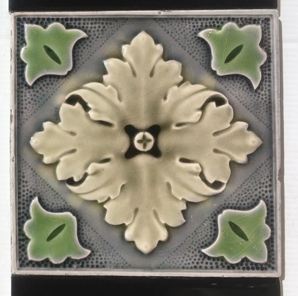salvaged, recycled, demolition, reproduction, restoration, renovation,collectable, secondhand, used , original, old, reclaimed, heritage, antique, victorian, art nouveau edwardian, georgian, art deco detail of Sherwin and Cotton original English embossed fireplace tiles, c 1895, unusual grey tones, matched with gloss black 6 x 3 inch tiles, 2 panel fireplace set $190 OTB 12