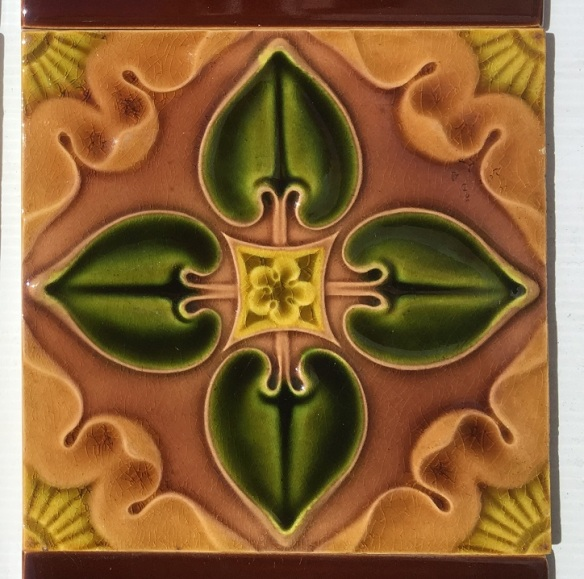 Detail of Pilkington Tile Co picture tiles, c1903, quatrefoil design in green to brown. 2 panel fireplace set, $180 SET 135 salvaged, recycled, demolition, reproduction, restoration, renovation,collectable, secondhand, used , original, old, reclaimed, heritage, antique, victorian, art nouveau edwardian, georgian, art deco