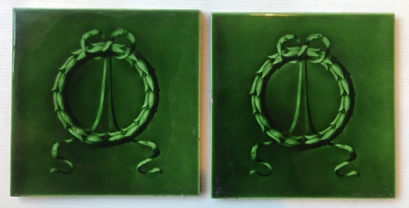 J. and W. Wade majolica feature tiles, England c 1902, Classic wreath and ribbon design, mould relief tile in rich green $85 pair SET 263 Original majolica feature tiles, England c 1900, Classic wreath and ribbon design, mould relief tile in rich green $85 pair WSOriginal Victorian moulded feature tiles for fireplace / washstand. Wreath and ribbon design, rich green glaze $75 pair WS salvaged, recycled, demolition, reproduction, restoration, renovation,collectable, secondhand, used , original, old, reclaimed, heritage, antique, victorian, art nouveau edwardian, georgian, art deco washstand tiles fireplace tiles