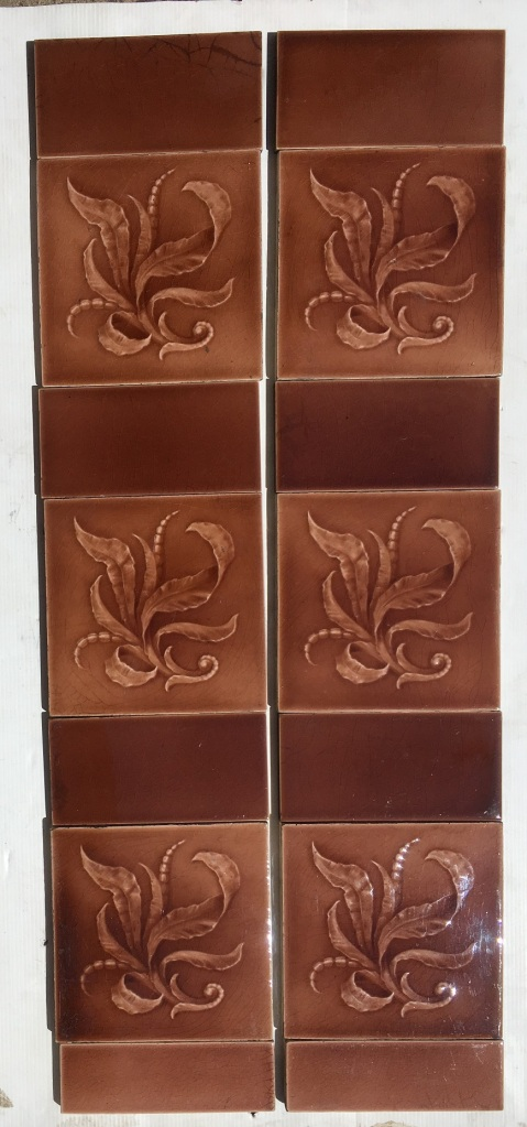 Original Sherwin and Cotton fireplace tiles, c1890 - 1911 warm pink / brown glaze on moulded tile with foliage. $300 for the two panel set SET 142