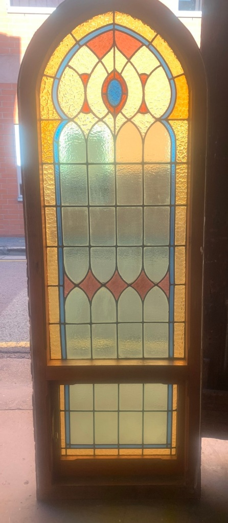 Arch church style window with red, blue, yellow and clear leadlight , 845 mm x 1780 mm , $1400 salvaged, recycled, demolition, reproduction, restoration, renovation,collectable, secondhand, used , original, old, reclaimed, heritage, antique, victorian, art nouveau edwardian, georgian, art deco