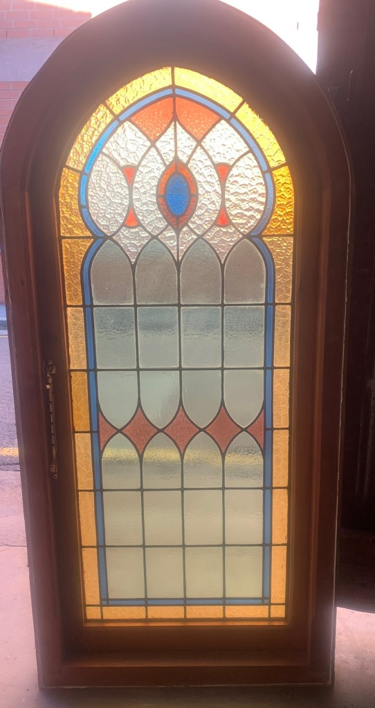 Detail of arch church style window with red, blue, yellow and clear leadlight , 845 mm x 1780 mm , $1400 salvaged, recycled, demolition, reproduction, restoration, renovation,collectable, secondhand, used , original, old, reclaimed, heritage, antique, victorian, art nouveau edwardian, georgian, art deco
