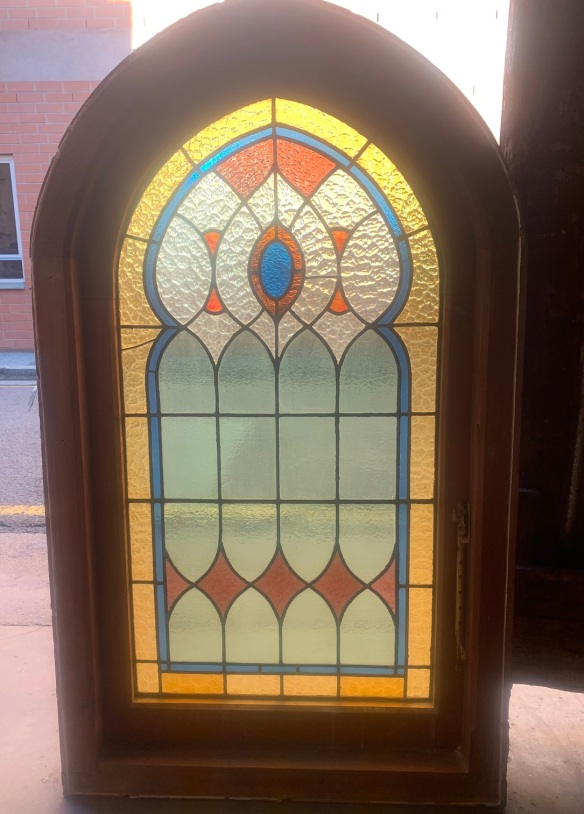 Detail of arch church style windows with bottom casement and red, blue, yellow and clear leadlight , 845 mm x 2250 mm , $ 1500 each , 2 matching available salvaged, recycled, demolition, reproduction, restoration, renovation,collectable, secondhand, used , original, old, reclaimed, heritage, antique, victorian, art nouveau edwardian, georgian, art deco