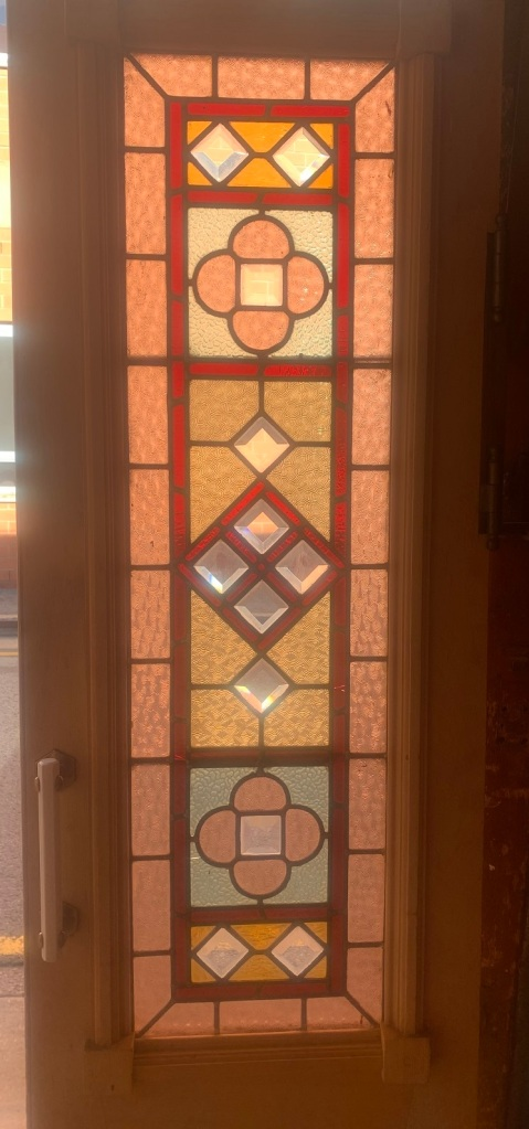 Detail of fantastic pair of French doors with full colour leadlight and bevel cut glass , nice timber decoration to the doors, 1030 mm wide x 2120 mm tall , $1400 the pair salvaged, recycled, demolition, reproduction, restoration, renovation,collectable, secondhand, used , original, old, reclaimed, heritage, antique, victorian, art nouveau edwardian, georgian, art deco